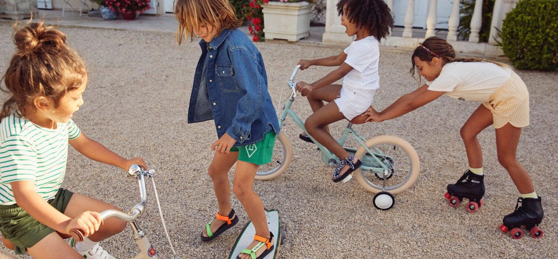 Kids outside on bike, roller skate and skateboard