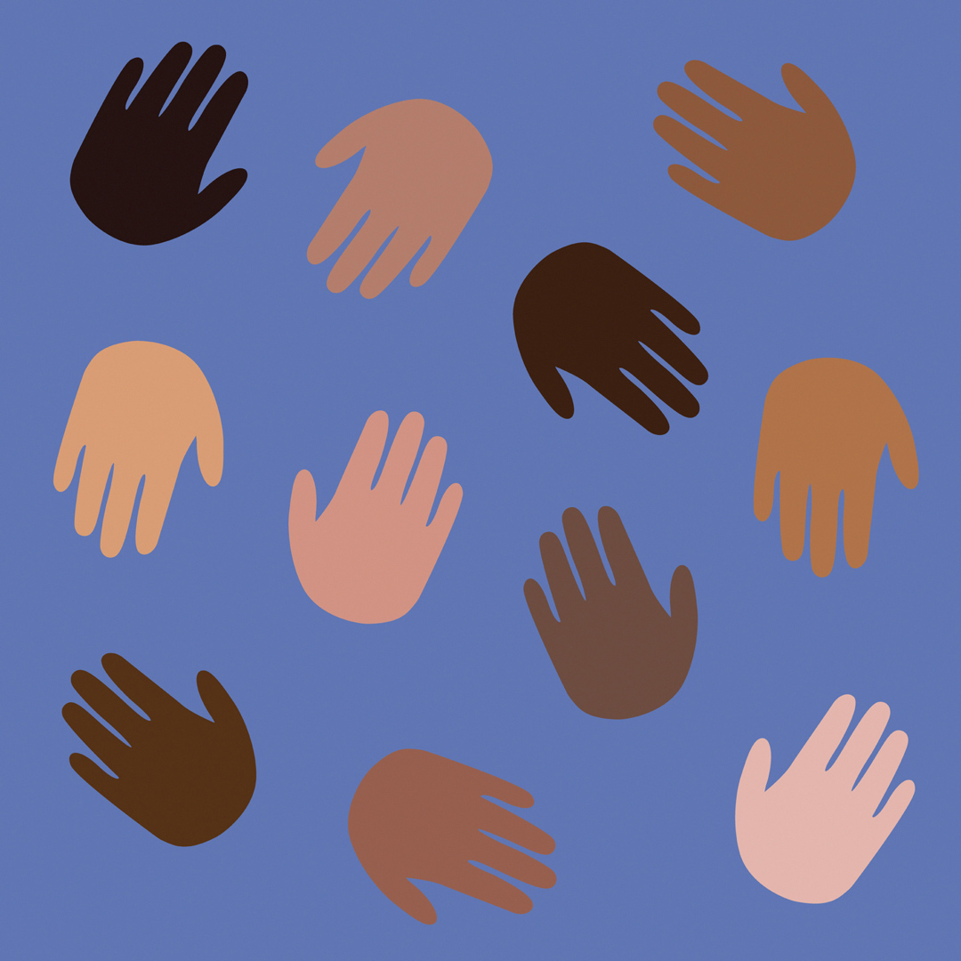 children's hands in a range of skin tones