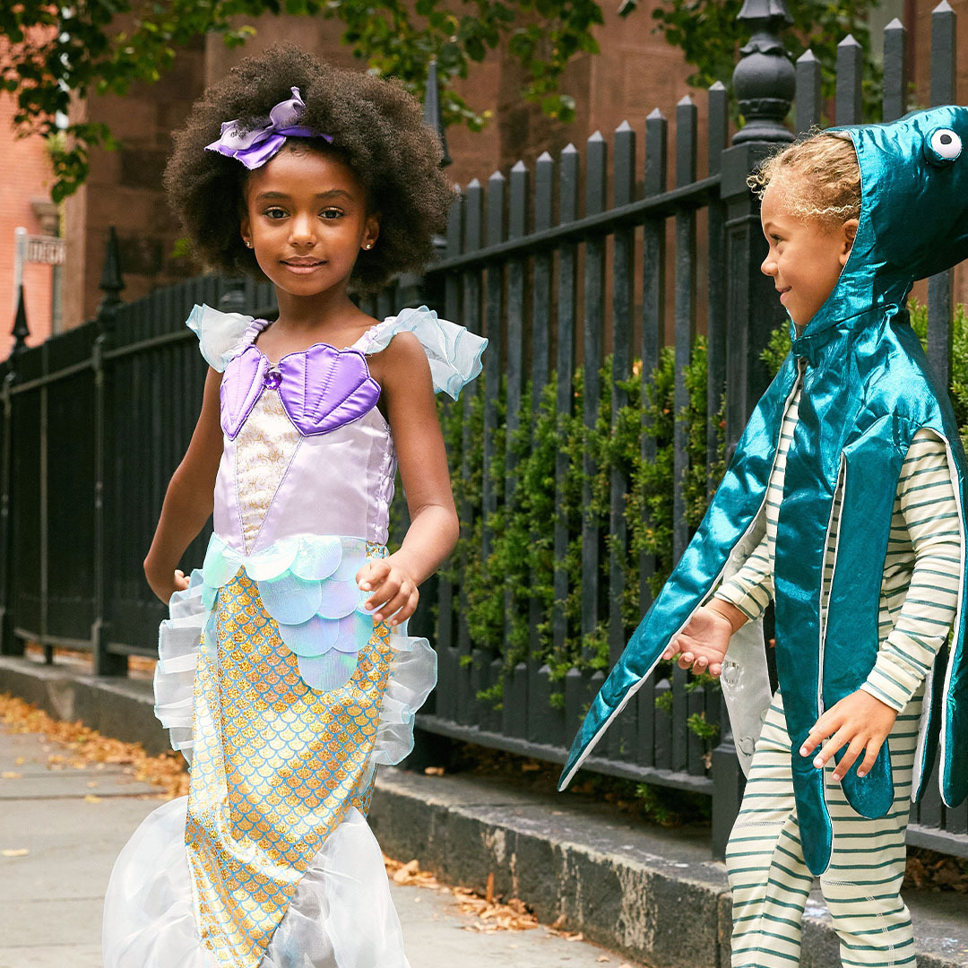 Children outside wearing costumes