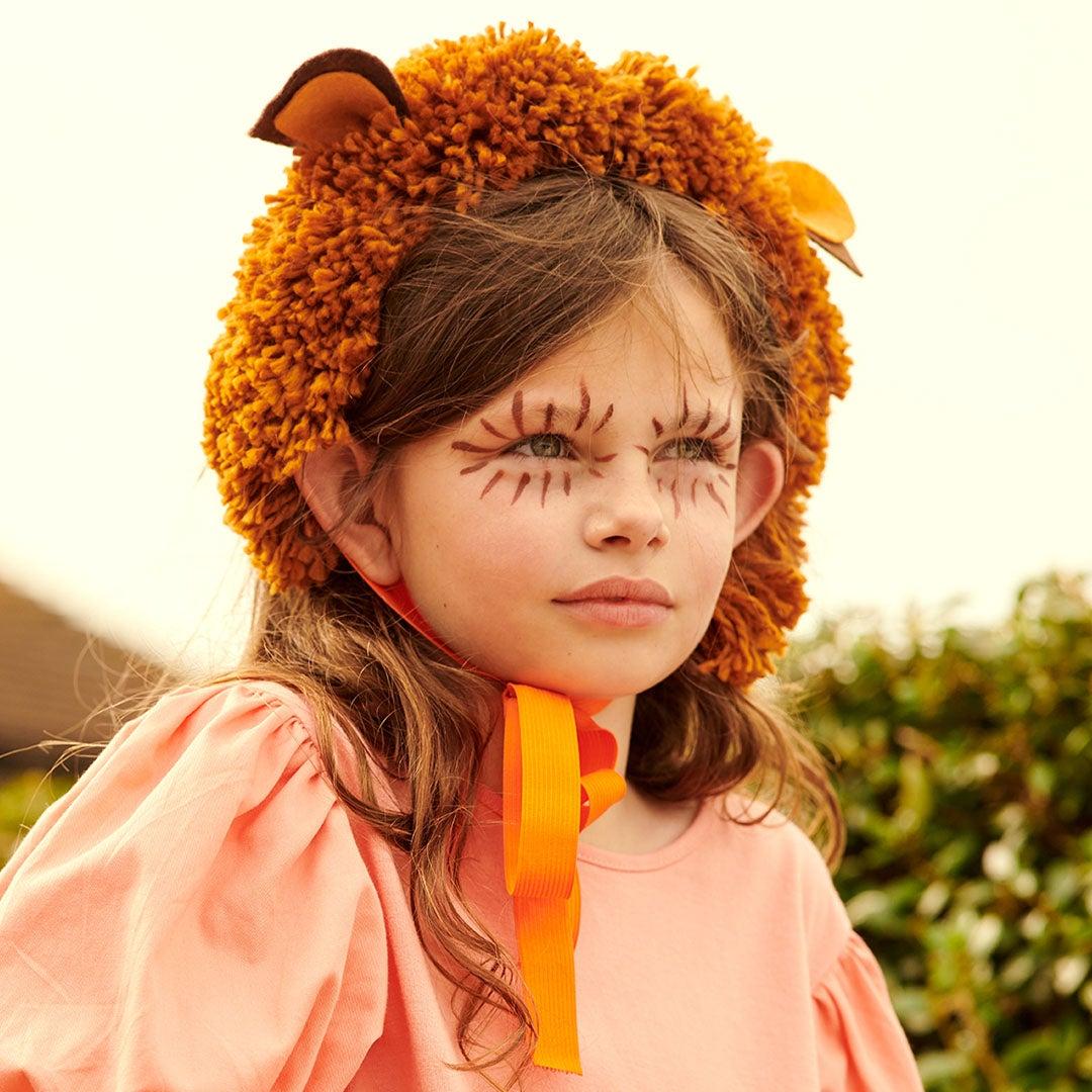 Girl wearing lion mane