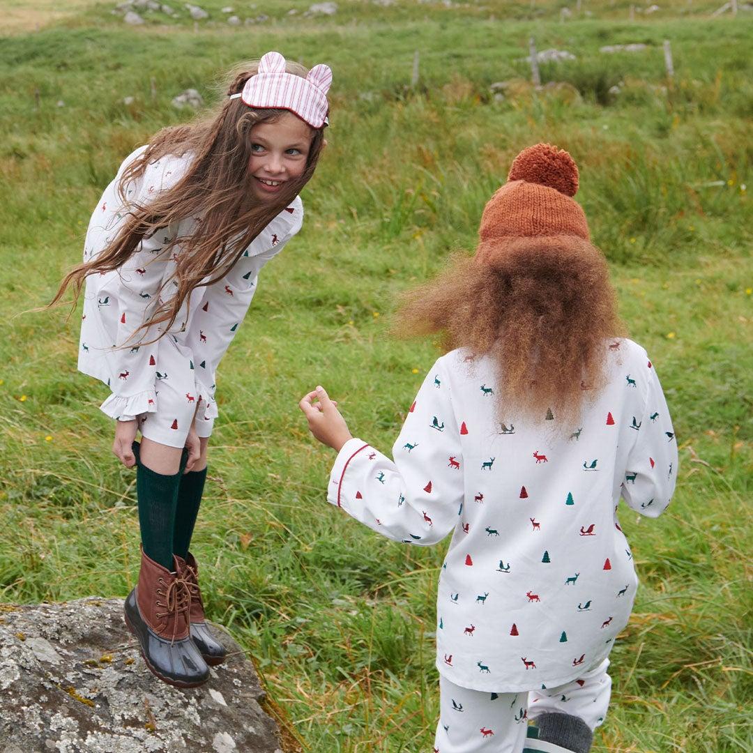 Girls outside wearing pajamas
